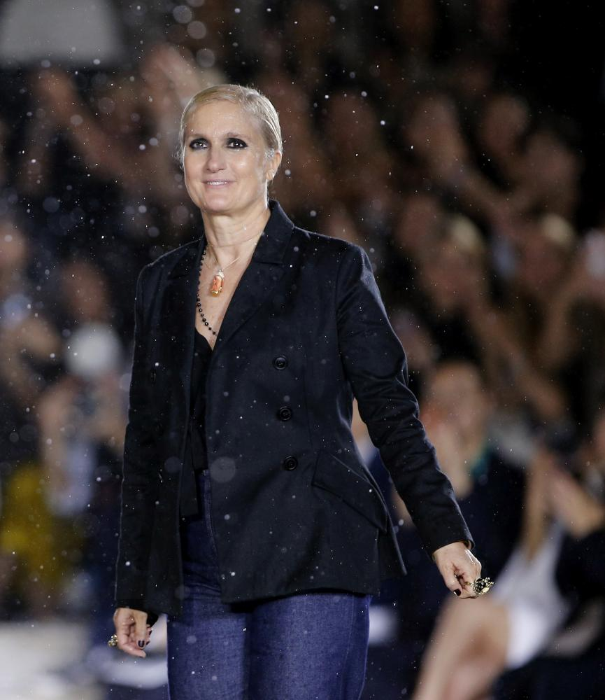 Italian fashion designer Maria Grazia Chiuri acknowledges the applause at the end of the show.