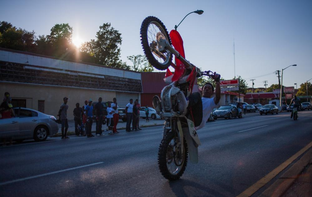 Chino – the most successful urban dirt biker in the world – pulling a vertical wheelie