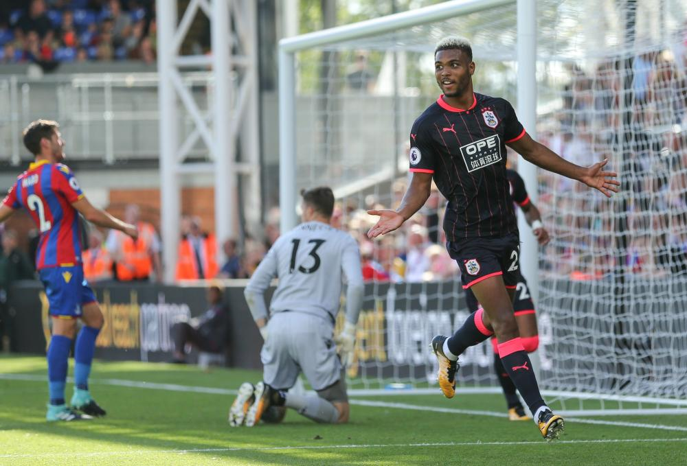 Steve Mounie celebrates after scoring the third.