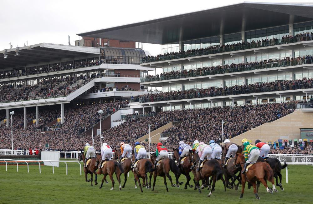 Runners in the first race pass by the packed main stands.
