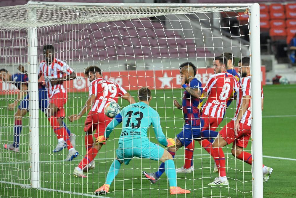 Atletico Madrid's Diego Costa scores an own goal.