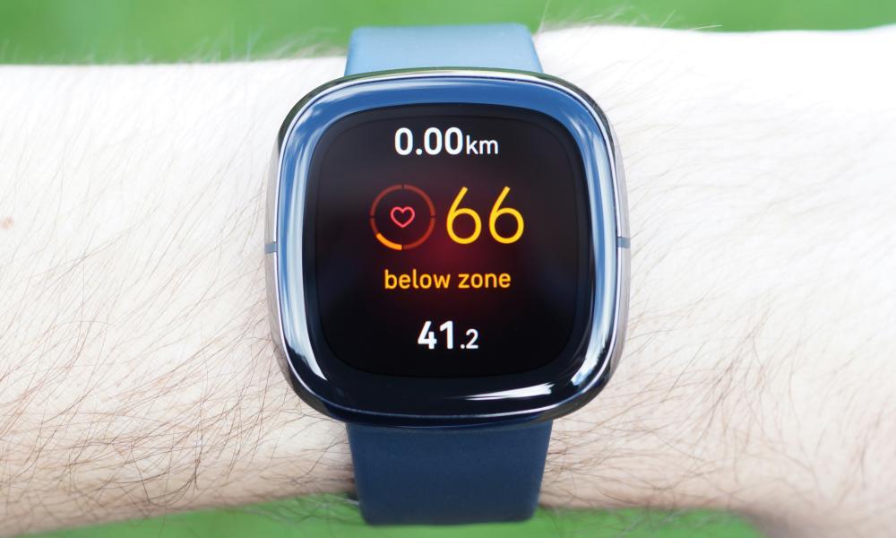 Fitbit Sense on wrist, showing heart rate