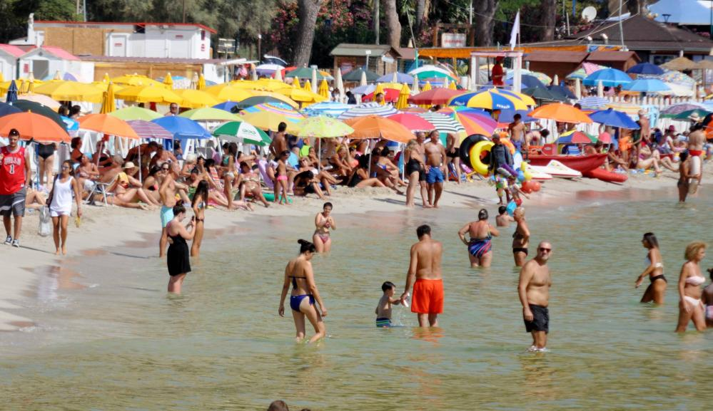 People enjoy the first weekend of August on Mondello beach in Palermo, Italy on 1 August 2020.