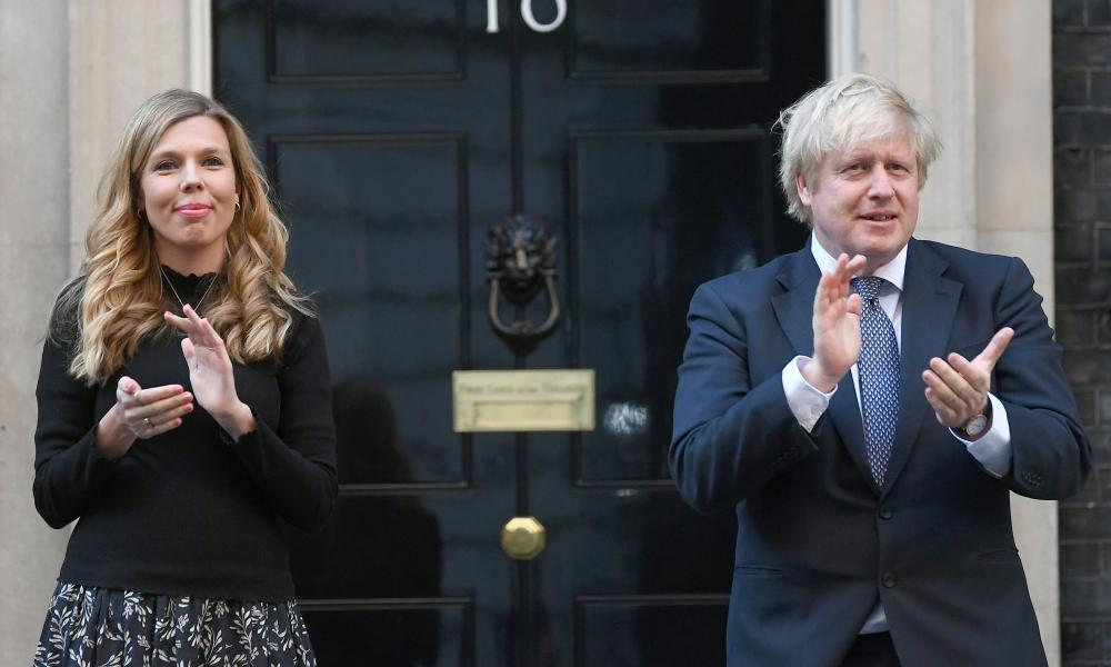 Boris Johnson and his partner Carrie Symonds, stand in Downing Street, London, to join in the Clap for Carers applause.
