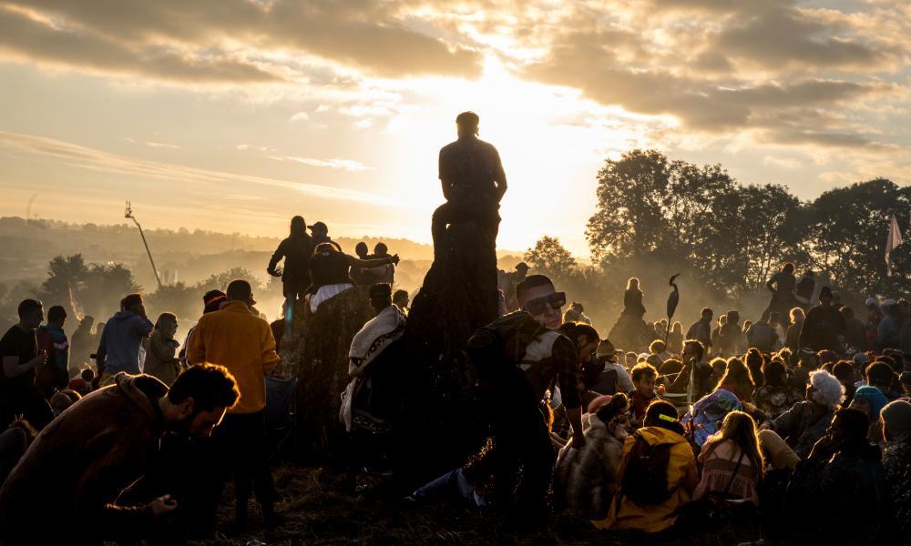 Dawn at the stone circle during Glastonbury festival, 26 June 2017.