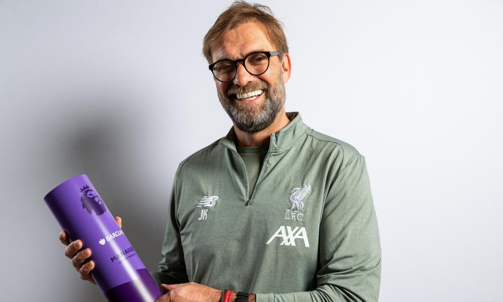 Jurgen Klopp poses with the Manager of the Month award for January.