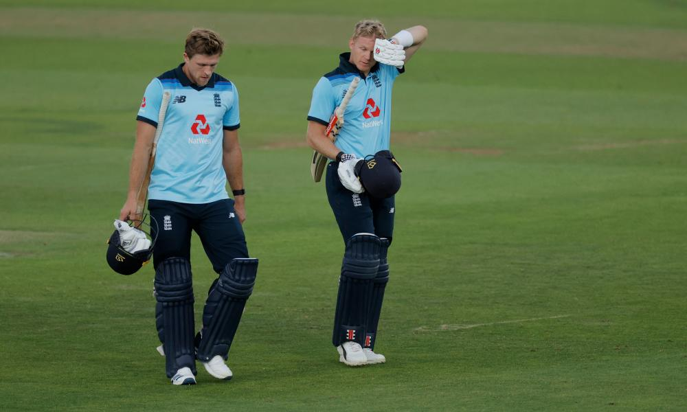 David Willey and Sam Billings walk off after England's victory.