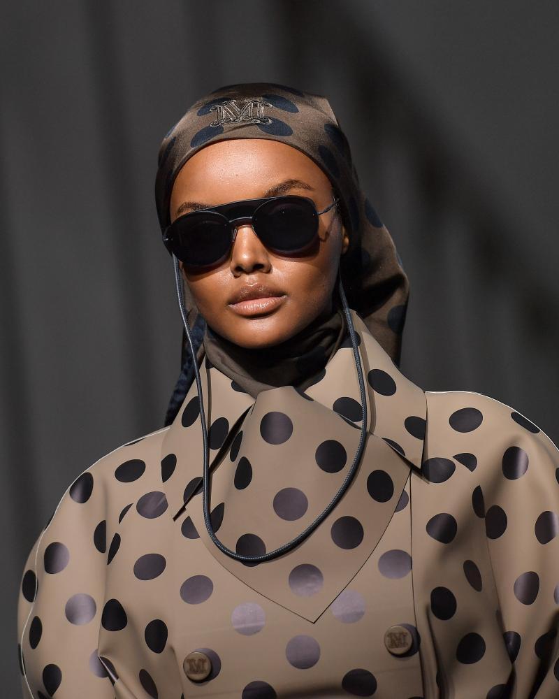 Halima Aden in polka dots and a headscarf.