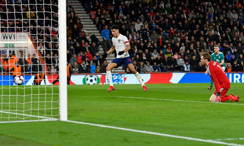 Bournemouth's Dominic Solanke, captain for the evening at Dean Court, rounds the keeper to equalise for England.
