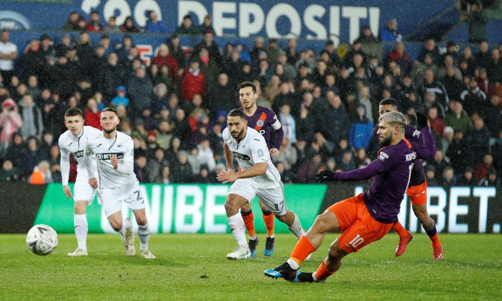Manchester City's Sergio Aguero takes their penalty.