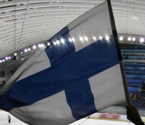 Senni Laaksonen, of Finland, waves a Finnish flag during the Finland-Germany 2006 Winter Olympics women's ice hockey match Saturday, Feb. 11, 2006, in Turin, Italy. Laaksonen's sister Emma Laaksonen plays on the Finnish ice hockey team (AP Photo/Julie Jacobson)