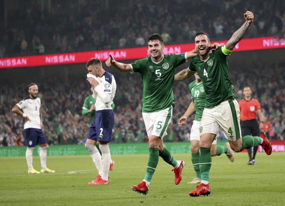 Republic of Ireland's Shane Duffy, right, and John Egan celebrate after Serbia's Sergej Milinkovic-Savic scored an own goal.