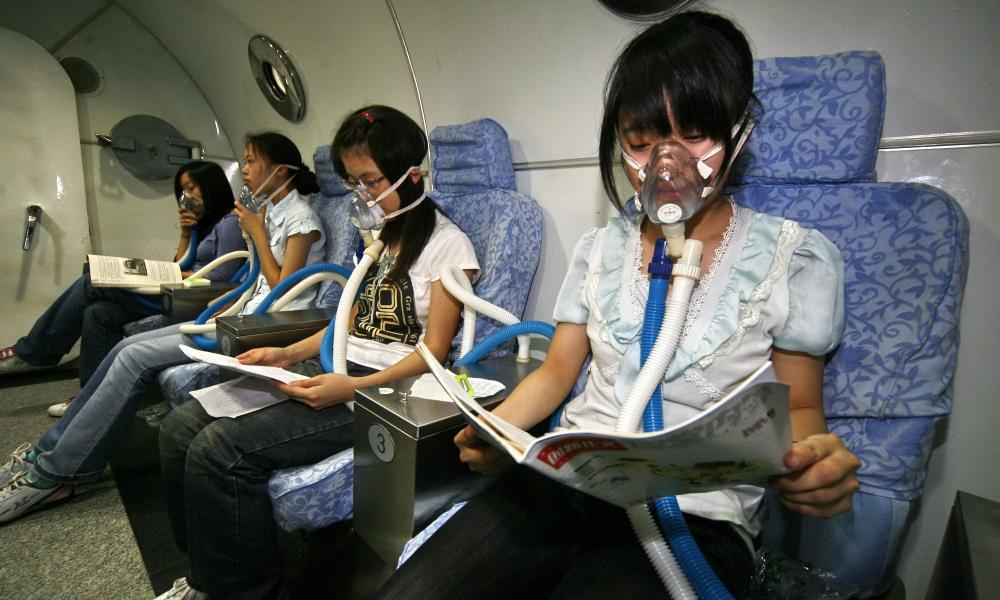Chinese students study in a hyperbaric chamber prior to exams.