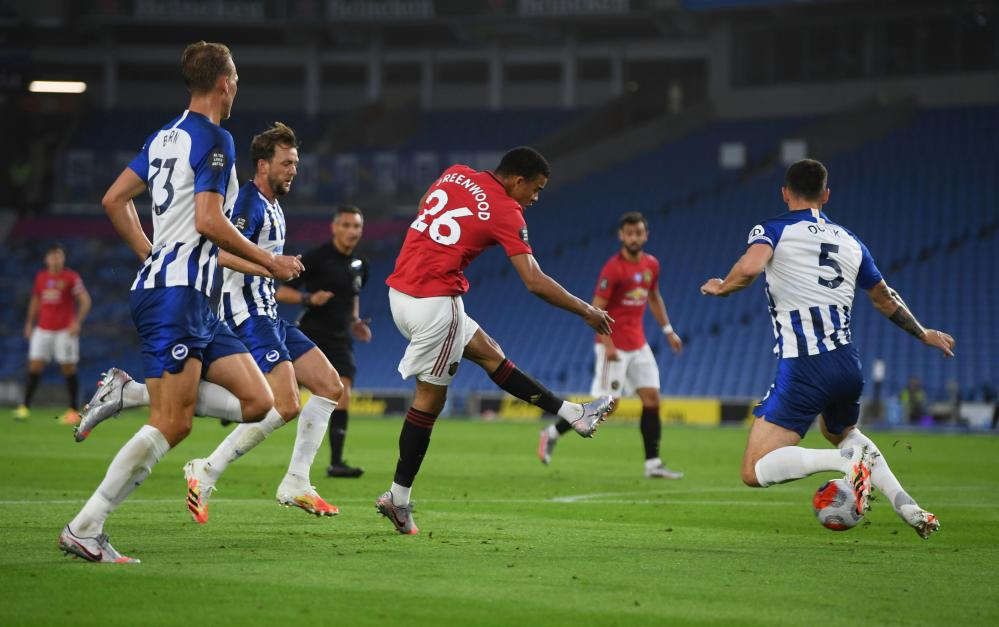 Manchester United's Mason Greenwood shoots low to open the scoring.