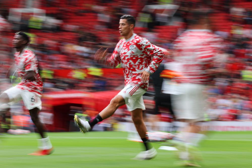 Manchester United's Cristiano Ronaldo warms up ahead of kick-off.