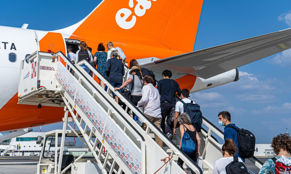Passengers prepare to board an easyjet flight at Rome Fiumicino Airport bound for London Gatwick Airport.