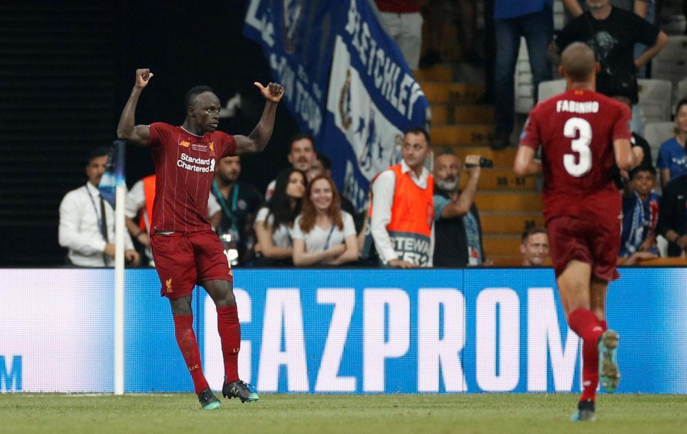 Mane celebrates scoring Liverpool's second goal.