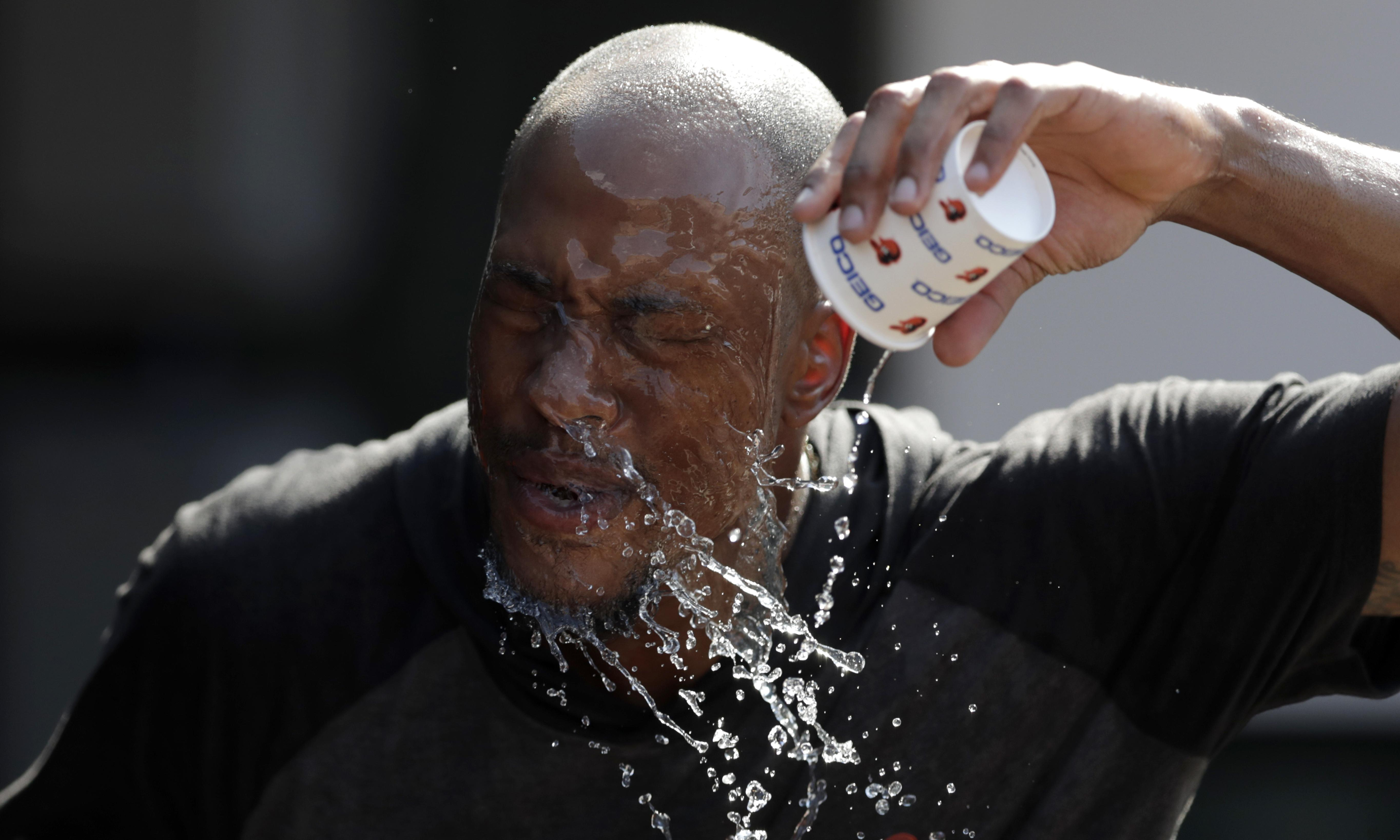 'Like pitching in a rainforest': MLB fans and players struggle in brutal heatwave