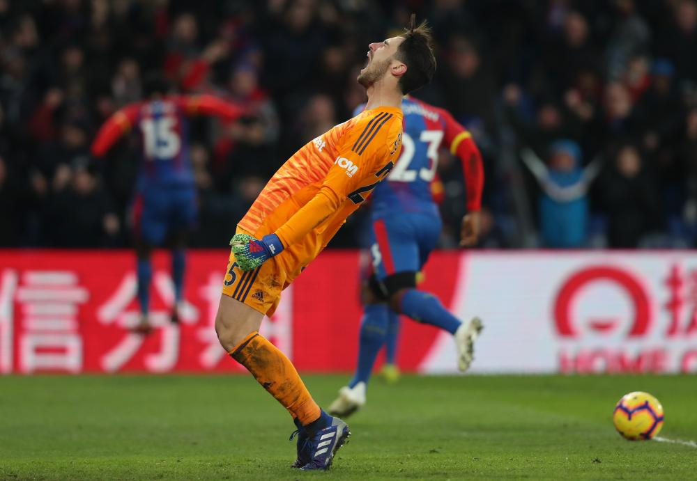 February 2: Sergio Rico of Fulham reacts in dismay as Jeffrey Schlupp of Crystal Palace celebrates scoring.