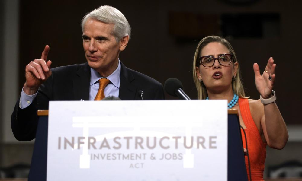 Rob Portman and Sinema answer questions from the press.
