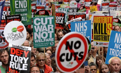 epa04810345 Tens of thousands of people march to parliament during an anti-austerity rally in London, Britain, 20 June 2015. Some seventy thousand anti-austerity marchers called for an end to government cuts.  EPA/ANDY RAIN