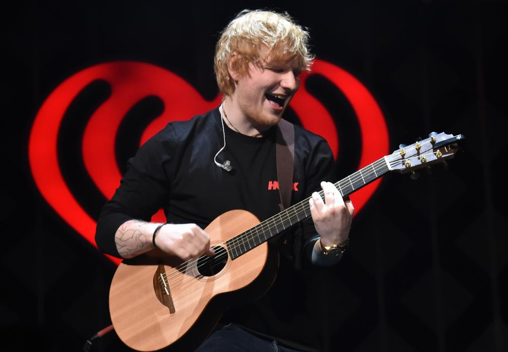 Ed Sheeran performing in New York in December – the singer-songwriter has four Brit nominations.