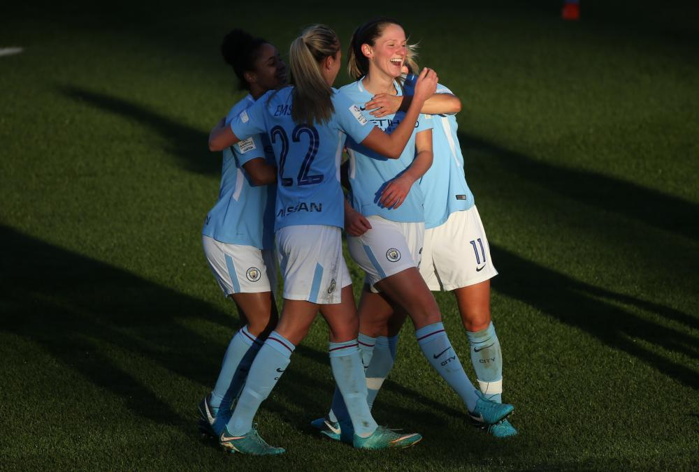 Abi McManus celebrates scoring for Manchester City.
