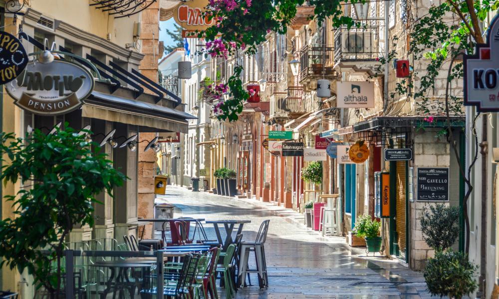 Restaurants on a street in Nafplio, Greece.