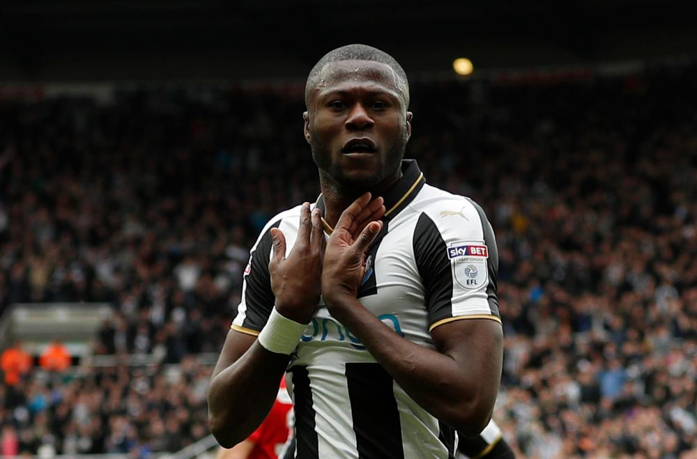 Chancel Mbemba celebrates scoring the second for Newcastle.