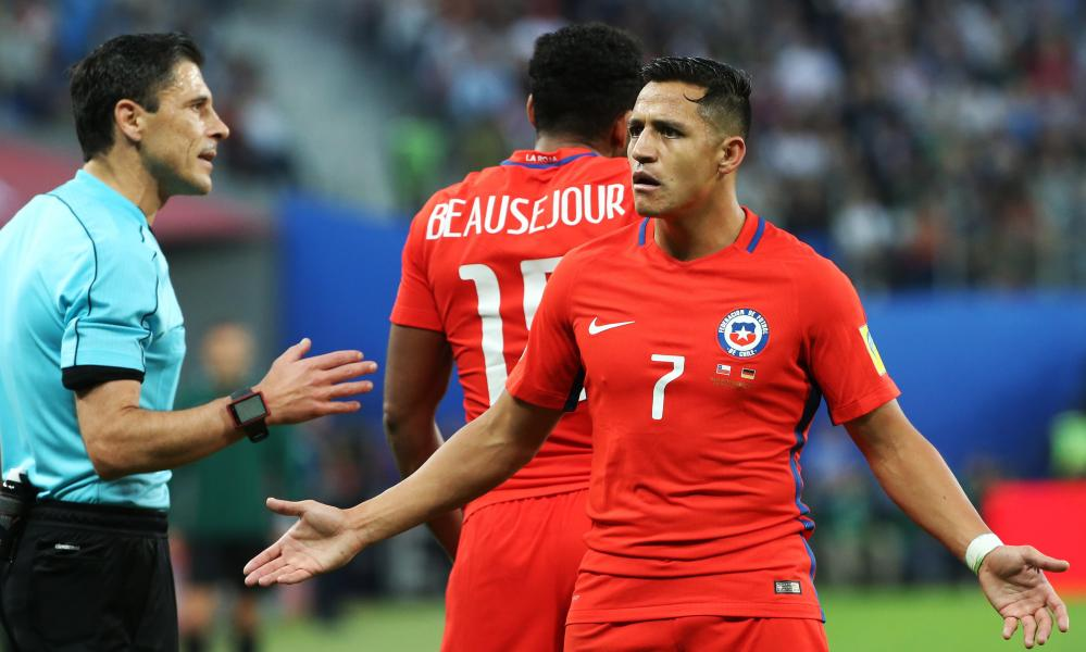 Alexis Sánchez is lost for words after failing to get a decision from the referee.