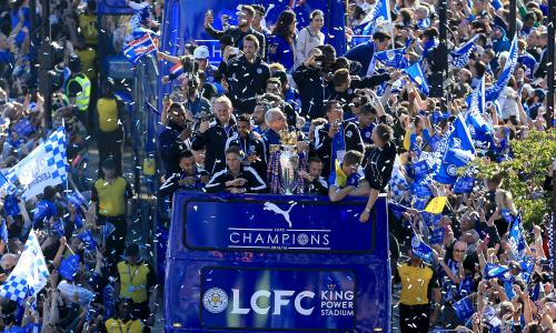 The Leicester City team celebrate winning the Premier League with an open-top bus parade through the city centre