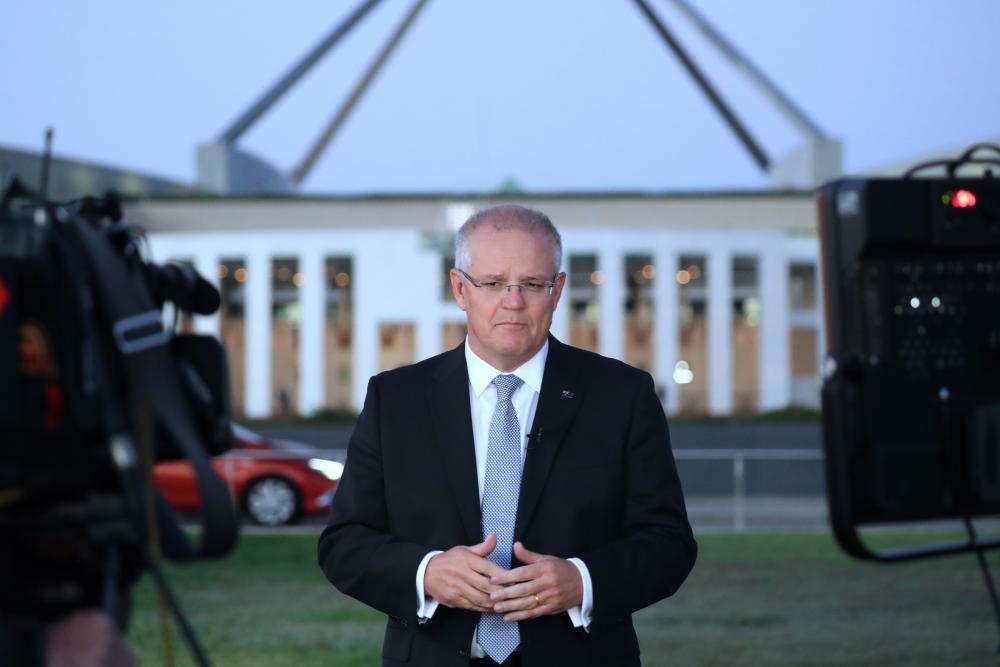 The prime minister, Scott Morrison, sells the budget