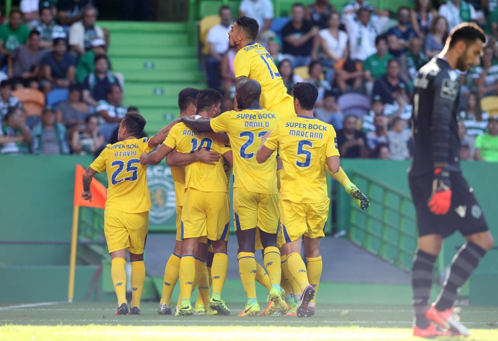 FC Porto players celebrate after scoring a goal against Sporting CP at Estadio Jose Alvalade on August 28, 2016 in Lisbon, Portugal.