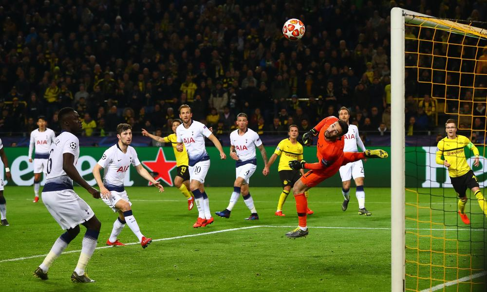 Tottenham Hotspur goalkeeper Hugo Lloris makes a diving save to deny Mario Gotze of Borussia Dortmund.