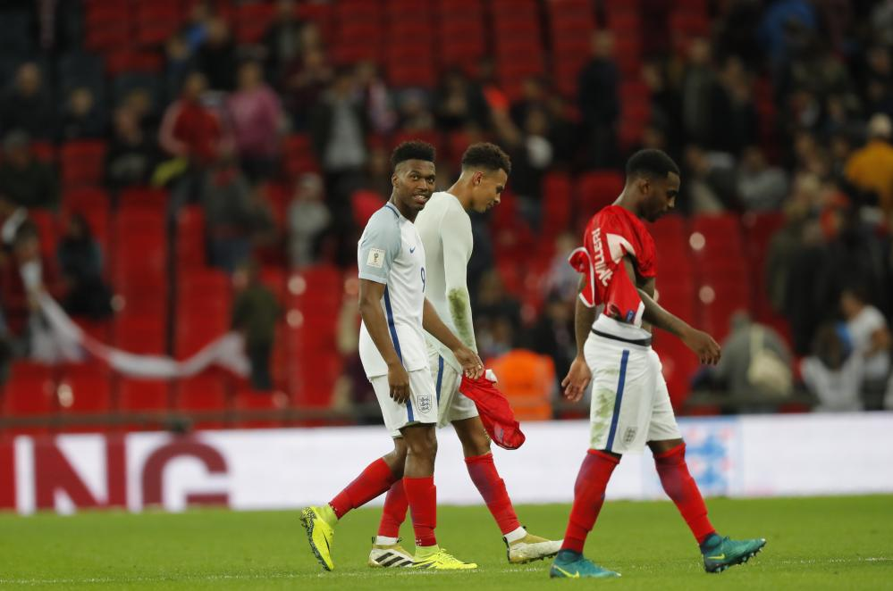 Sturridge and Alli leave the field after the final whistle.