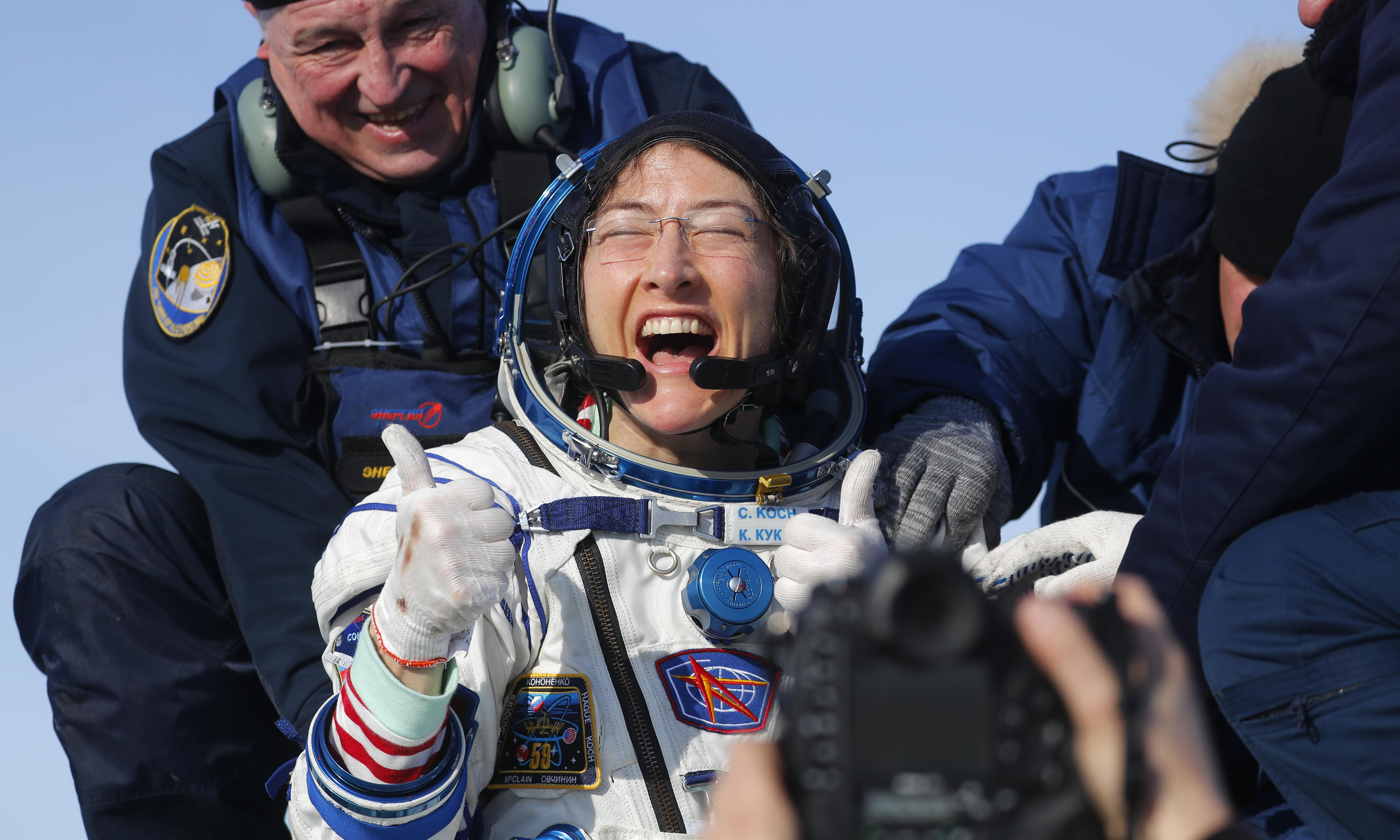 Christina Koch returns to Earth after record-breaking space mission