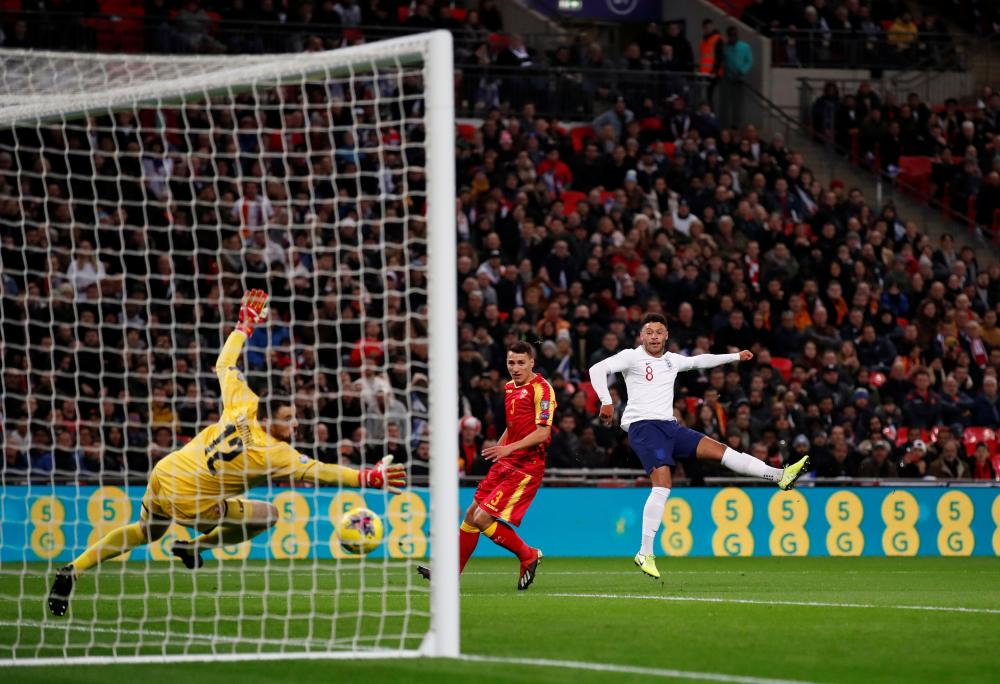Alex Oxlade-Chamberlain of England scores his sides first goal