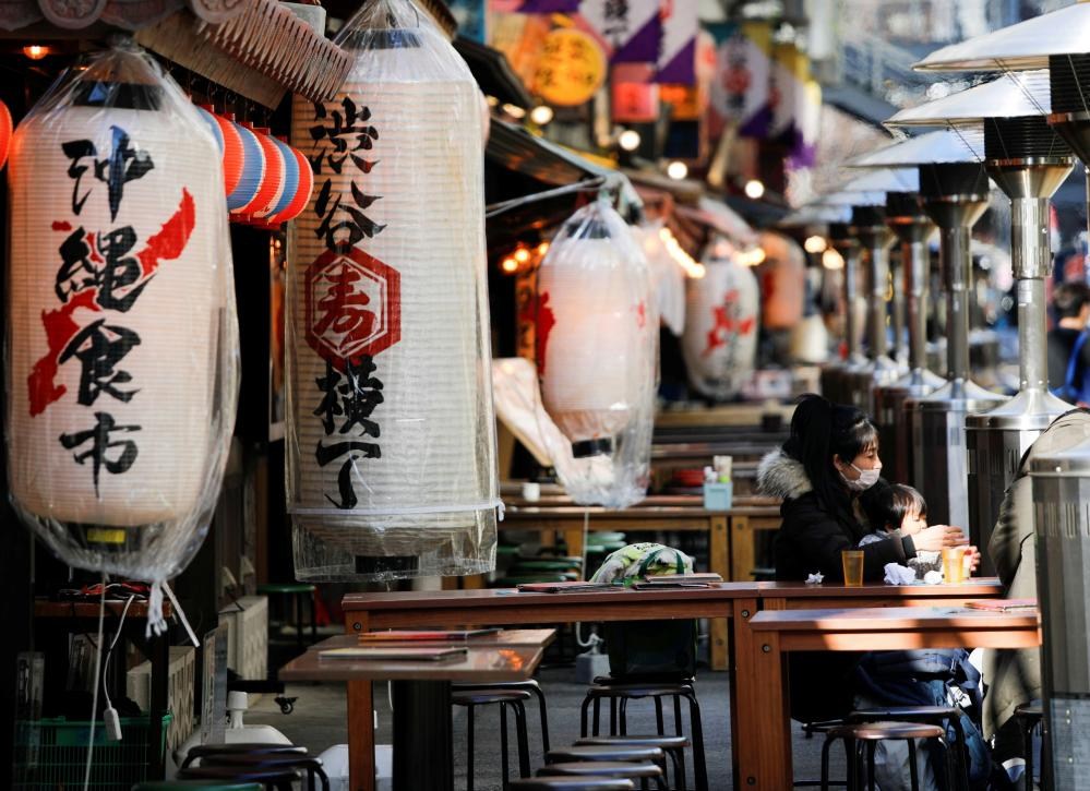 A woman and child have lunch amid a new Covid-19 outbreak in Tokyo