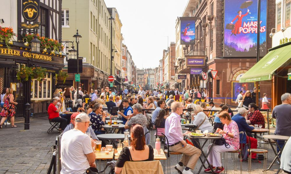 Busy restaurants and cafes are seen in Old Compton Street in Soho, London.