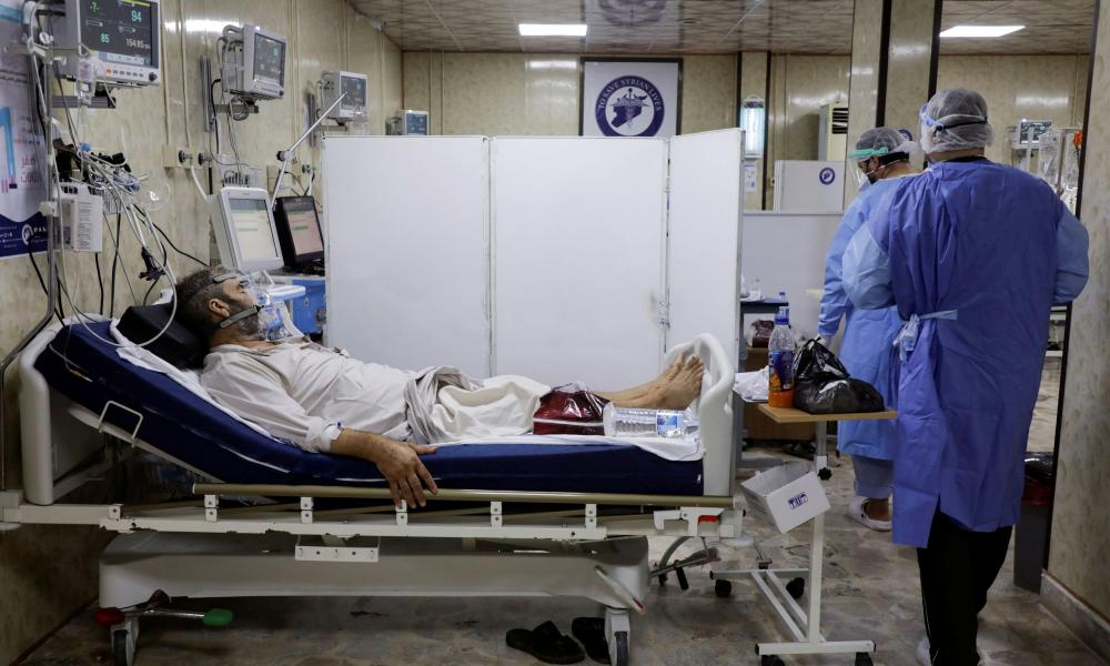 Medical staff assist patients suffering from the coronavirus disease inside the COVID-19 ward of a hospital in the opposition-held Idlib, Syria.