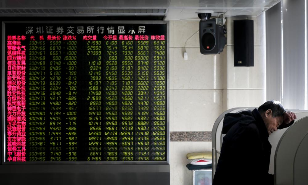 An investor checks stock prices on a screen at a brokerage house in Beijing, Tuesday, Jan. 26, 2016. Asian stock markets sank Tuesday, led by a plunge in the Shanghai index, after a renewed slump in the price of oil kept investors on edge about the global economy. (AP Photo/Andy Wong)