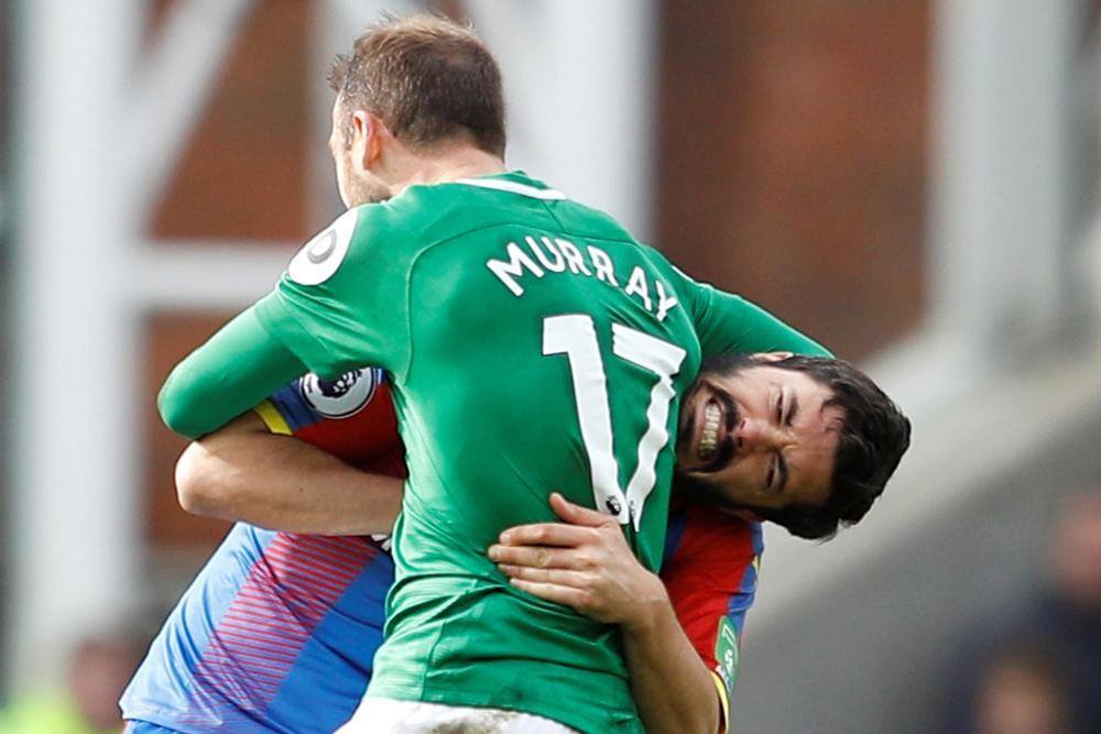 March 9:9 Crystal Palace's James Tomkins ingets headlocked by Brighton's Glenn Murray.