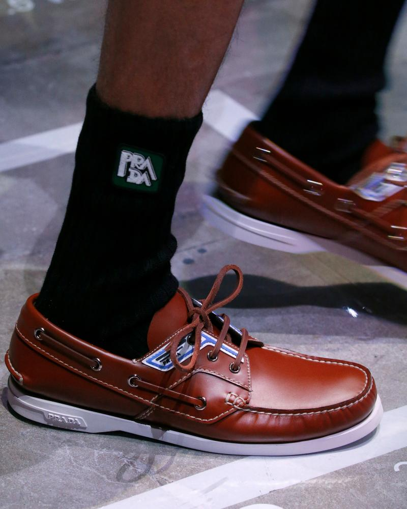 Prada deck shoes with tube socks