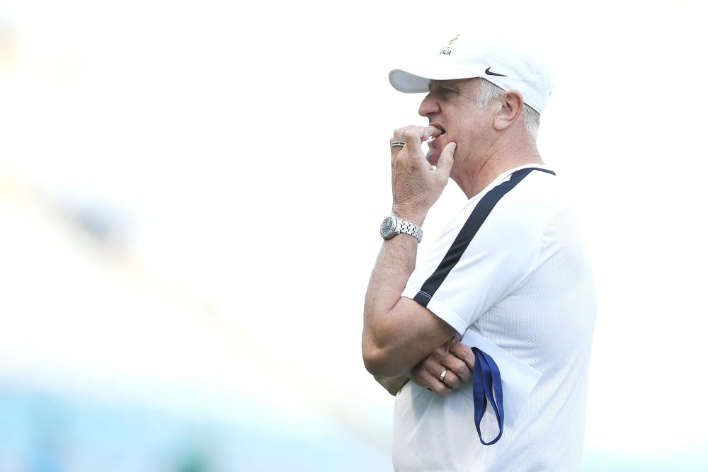 Socceroos coach Graham Arnold watches on during a training session at ANZ Stadium.