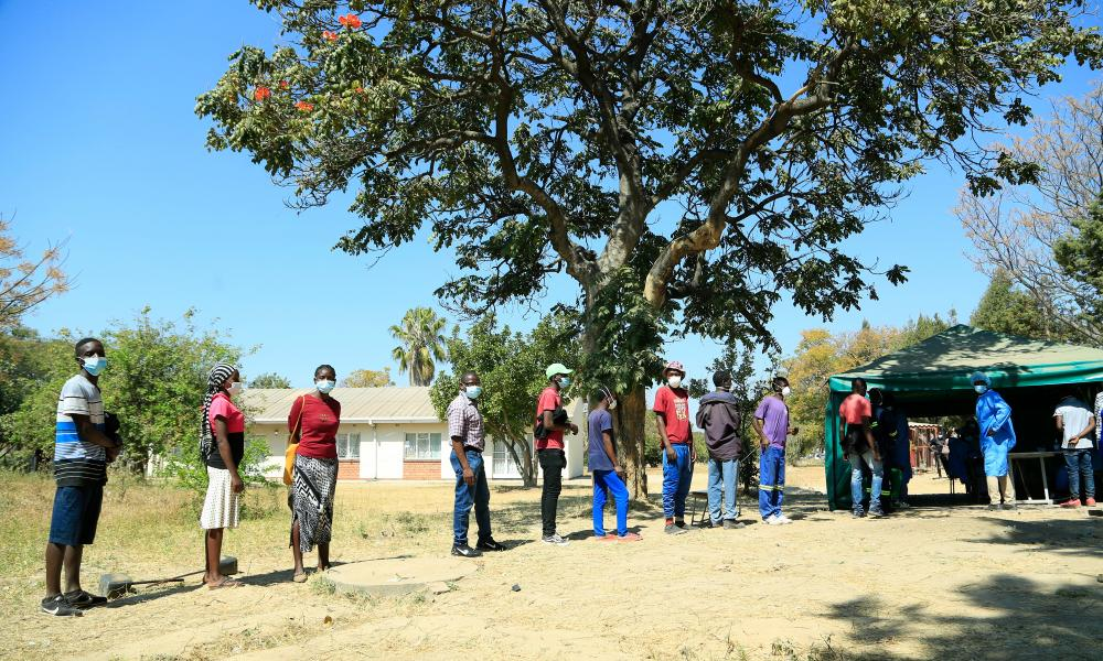 People wait to be vaccinated at Chitungwiza General Hospital, Chitungwiza, Zimbabwe.