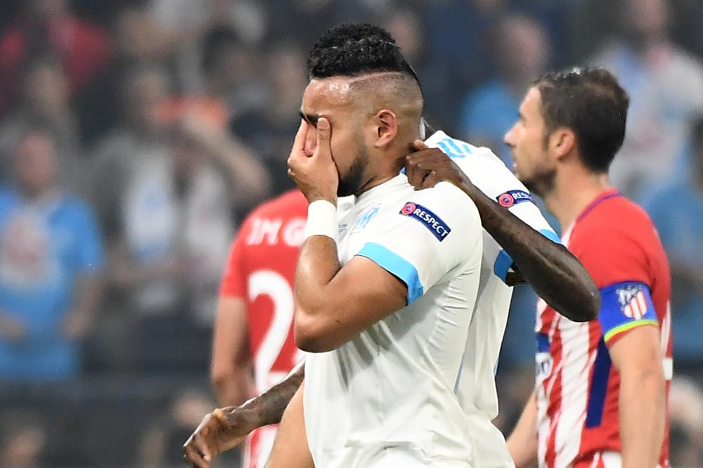 Marseille's Dimitri Payet tries to hide his tears of disappointment as he leaves the pitch.
