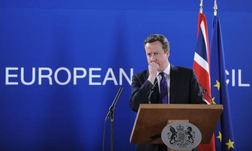 British Prime Minister David Cameron speaks at a press conference at the EU Headquarters on February 8, 2013 in Brussels, on the last day of a two-day European Union leaders summit. After 24 hours of talks lasting through the night, European Union leaders finally clinched a deal on the bloc's next 2014-2020 budget, summit chair and EU president Herman Van Rompuy said Friday.
