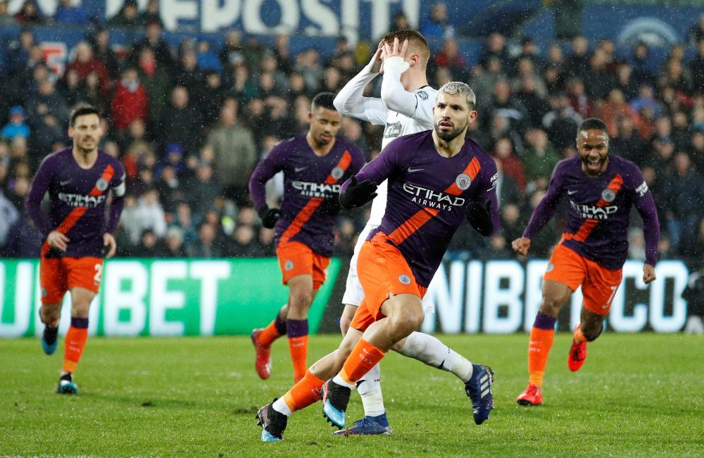 Manchester City's Sergio Aguero celebrates scoring their second goal from the penalty spot.