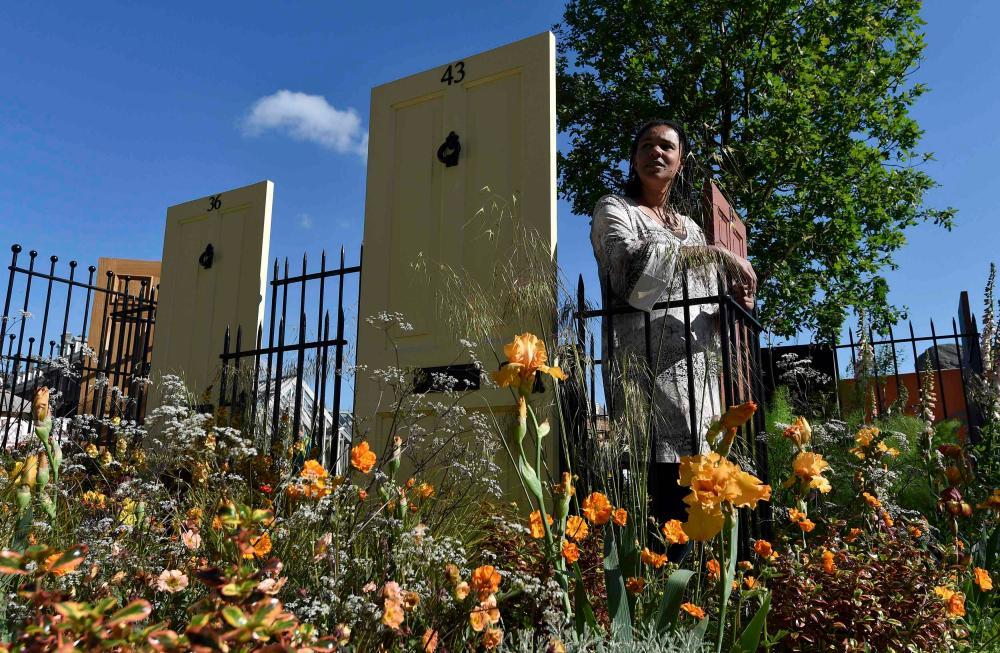 British landscape designer Juliet Sargeant stands in her Modern Slavery Garden