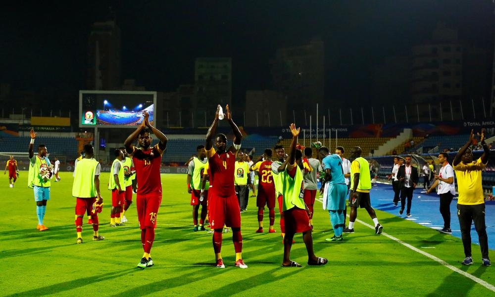 Ghana players applaud their fans after the match.